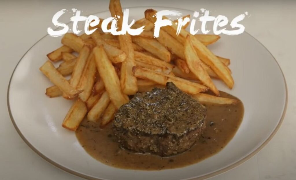 Tofu minute steak with black pepper sauce and Pommes Frites