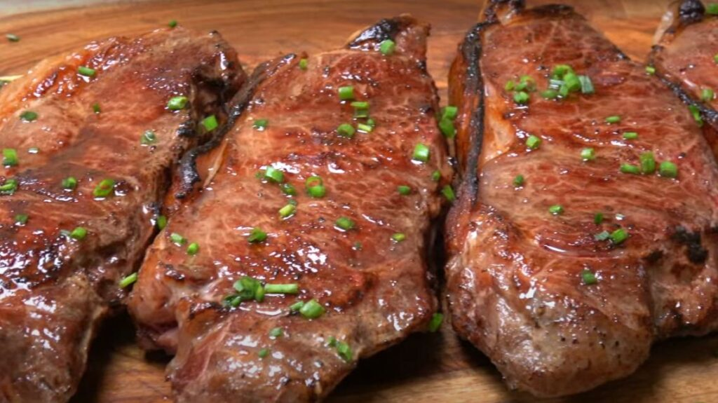SOUS VIDE STRIP STEAKS + CHIVES AND GARLIC
