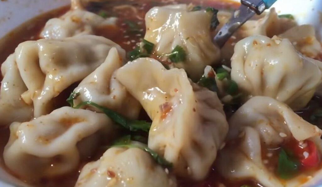 Asian vegetable soup with dumplings